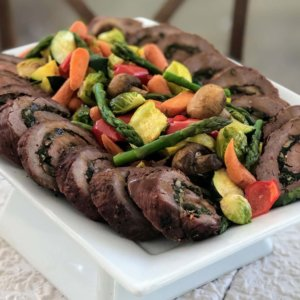 Mushroom and Spinach Stuffed Flank Steak with Summer Harvest Vegetables